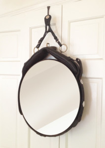 This mirror is made with a surcingle. (Photo via www.octoberdesigncompany.com).