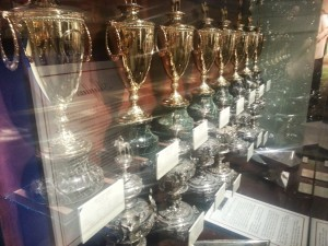 Kentucky Derby, Preakness, Belmont (the plates), and two Triple Crown trophies.